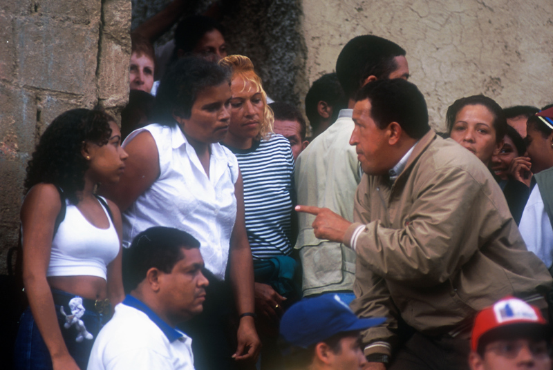 Hugo Chavez greets people in Caracas